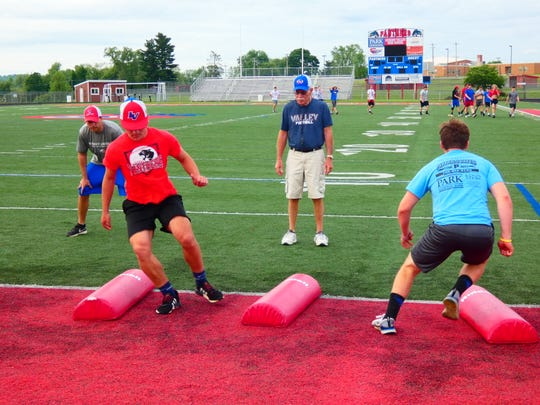 Licking Valley football coach Randy Baughman oversees conditioning May 27. The state government and Ohio High School Athletic Association still are developing a plan for guidelines related to the coronavirus pandemic for the regular season set to begin in late August.