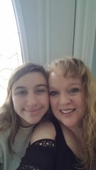 Certified Registered Nurse Anesthesiologist (CRNA) Beth Tuma of Granville is shown with her daughter Emily, a State Tested Nurse Assistant (STNA) who was with her in New York City.