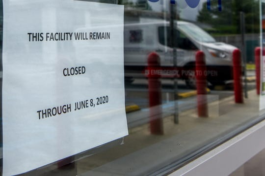 The New Jersey Motor Vehicle Commission has been closed since March due to the COVID-19 pandemic. A sign hangs in the window of the empty NJMVC in Lodi on Thursday May 28, 2020.