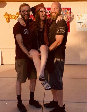 Ryan Whitaker, right, and his two children, Taylor, middle, and Matthew, celebrate his daughter's high school graduation.