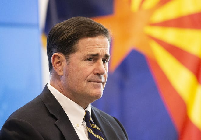 Arizona Gov. Doug Ducey meets with mayors to present the state's plan to allocate dollars from the CARES Act during the COVID-19 pandemic at the Arizona Commerce Authority in Phoenix.