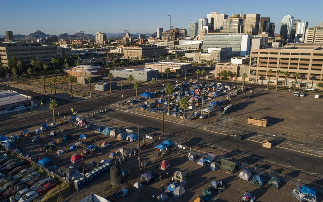 Homeless tents are erected in lots west of downtown Phoenix on May 27, 2020.