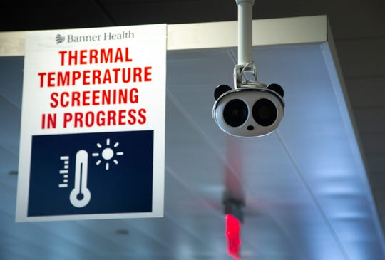 Thermal cameras monitor all employees' temperatures on May 19, 2020, as they enter the Banner University Medical Center Phoenix.