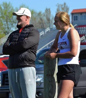 Port Clinton's Marie Gluth talks to throws coach Phil Fought.