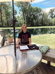 Port Clinton's Marie Gluth signs her national letter of intent for the women's crew team at Ohio State with a coronavirus safe announcement.