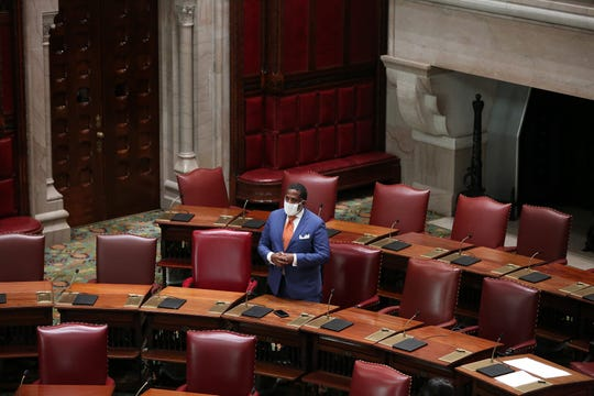 New York State Sen. Kevin Parker speaks in a nearly empty chamber Tuesday. Lawmakers returned to the Capitol, most of them virtually, to pass COVID-19 bills; May 28, 2020.