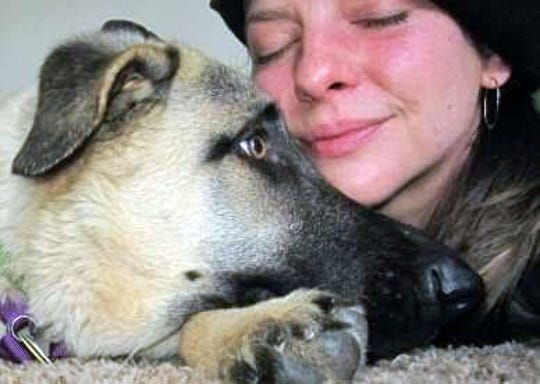 Erin Wagner, a lover of animals, snuggles with her dog, Gypsy. Wagner died on April 26 after falling from a deck at a home in Dunsmuir into the Sacramento River.