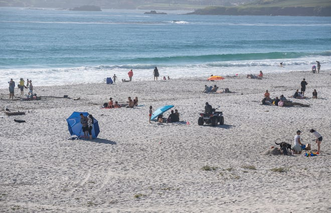 Hundreds of people flocked to Carmel Beach during the heatwave that struck Monterey County on Wednesday, May 27, 2020.