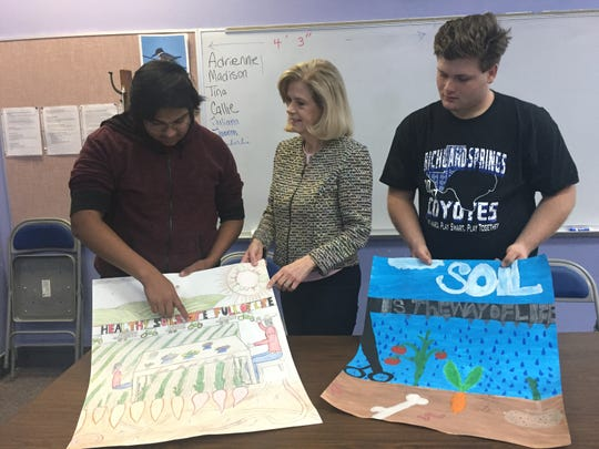 Richland Springs teacher Patsy Hall, center, discusses a soil conservation project with her students.