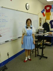 Patsy Hall, a teacher at Richland Springs ISD, wears her costume as Dorothy from The Wizard of Oz, while teaching a class.