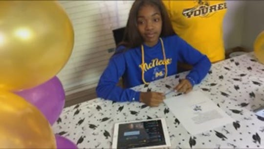 Byrd's Kayla Harrison signs scholarship papers with McNeese.