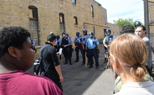 Police and protestors face off near the Minneapolis Police Department's Third Precinct headquarters Thursday, May 28, 2020, in Minneapolis, Minn.