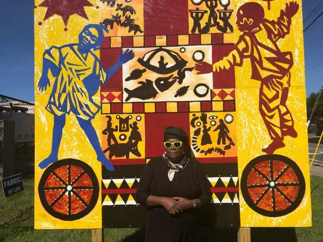 "Pamela ""Kabuya"" Bowens-Saffo poses with her artwork."
