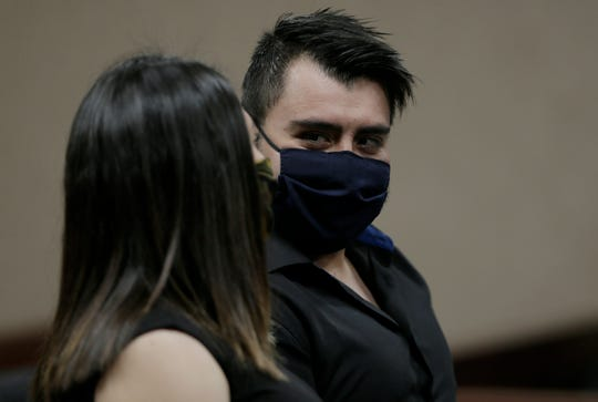 Groom David Espinoza looks at his new bride, Karen, during their wedding ceremony on May 27 at the El Paso County Courthouse. Because of COVID-19 restrictions, the bride and groom had to wear masks. Karen Espinosa said the masks didn't ruin her special day.