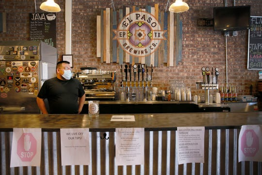 El Paso Brewing Co. manager of operations Lorenzo Zavala opens the bar Thursday, May 28, in El Paso. El Paso Brewing Co. is preparing for phase two of businesses reopening in Texas Thursday, May 28, in El Paso.