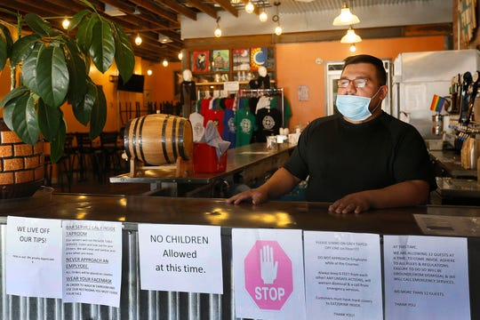 El Paso Brewing Co. manager of operations Lorenzo Zavala opens the bar Thursday, May 28, as bars prepare for phase two of businesses reopening Friday.