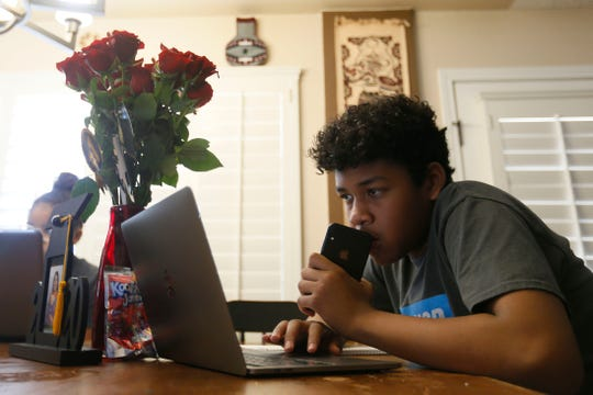 Coby Ray, a seventh-grader at Col. John O. Ensor Middle School, finishes up his curriculum for the end of the school year Tuesday, May 26, 2020, at his home in El Paso.