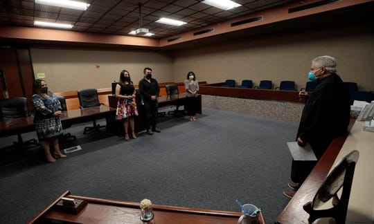 Probate Judge Eduardo Gamboa officiates the marriage of Karen and David Espinoza on May 27 in downtown El Paso. COVID-19 restrictions required everyone to wear masks, practice social distancing and get their temperature checked before entering the courthouse.