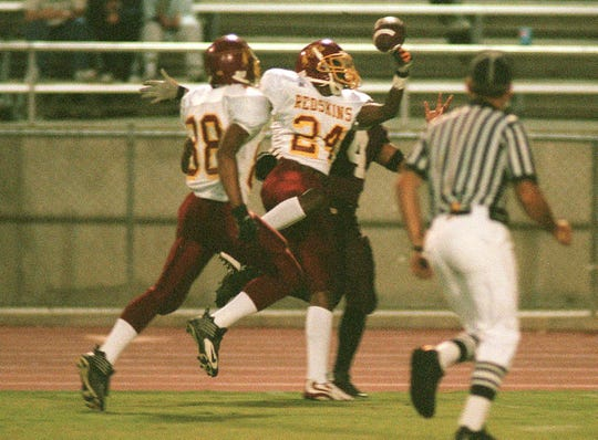 Tulare Union's Randy Jordan breaks up a pass against Mt. Whitney at Sunkist Stadium in 1999.