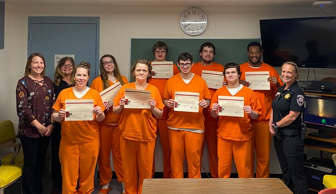 Eight Wood County inmates and staff and Mid-State Technical College staff celebrate the inmates' completion of the Career Development course. From left, Amber Stancher, Mid-State dean; Trish Zdroik, Mid-State instructor; Jamie Rezin; Ashley Stone; Gerri Klein; Allen Rice; Corday Alarie; Cody Schladweiler; Dakota Gecht; Daniel Rogers and Lt. Melissa Saeger.