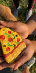 A painted rock that looks like a pizza was hidden and found somewhere in Wichita Falls. People are posting their finds on the WF Rocks Facebook or Instagram.