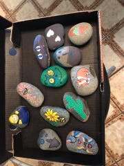 An offering of rocks painted by Kathy Sanderholm Mcgowan is ready for hiding. Hiding and finding painted rocks is providing socially distanced fun during the coronavirus situation.
