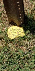 """A painted rock says, """"Change the world by being yourself,"""" is seen somewhere in Wichita Falls. Hiding and finding painted rocks is providing socially distanced fun during the coronavirus situation."""