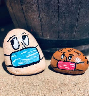 Rocks painted by Jamie Graham feature faces wearing masks and were hidden for others to find somewhere in Wichita Falls. Hiding and finding painted rocks is providing socially distanced fun during the coronavirus situation.