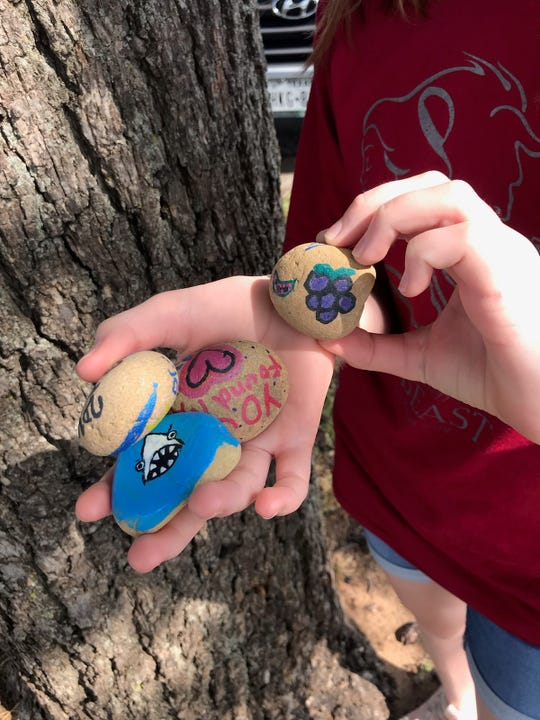 Isabelle Roe, 11, holds rocks she painted as she prepares to hide them in a Wichita Falls park. WF Rocks began last year as an online group where people can share their rock creations and finds. The group has now grown to nearly 1,000 members.