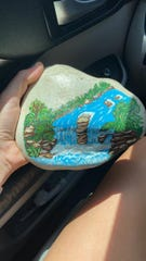A rock painted with a waterfall seen was found somewhere in Wichita Falls. Hiding and finding painted rocks is providing socially distanced fun during the coronavirus situation.