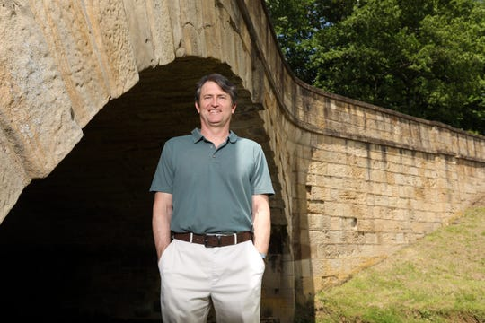 Professor and author Greg Wilson stands near the S Bridge in New Concord. Wilson, a New Jersey native, teaches history at the University of Akron.