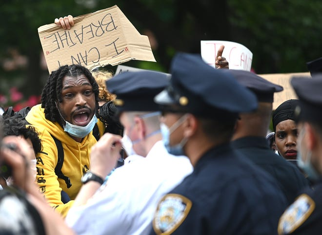 Protesters shout at policemen during a Black Lives Matter demonstration May 28 in New York City.