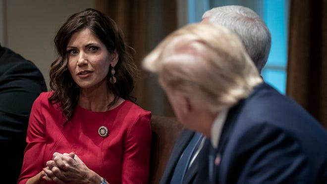Governor of South Dakota Kristi Noem speaks as U.S. President Donald Trump listens during a meeting about the Governors Initiative on Regulatory Innovation in the Cabinet Room of the White House on December 16, 2019 in Washington, DC.