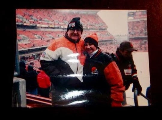 Beth Rosenberg Sanders and her dad at a Cleveland Browns game.