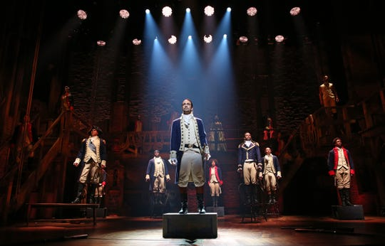 """""""Hamilton,"""" starring creator Lin-Manuel Miranda (center) as Alexander Hamilton, is coming to audiences at home July 3 in a filmed production with the original Broadway cast on Disney+."""
