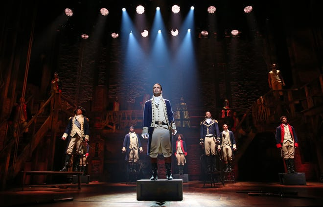 """""""Hamilton"""" stars actor Lin-Manuel Miranda (center) and a diverse cast to retell the story of Alexander Hamilton, one of the Founding Fathers of the United States."""