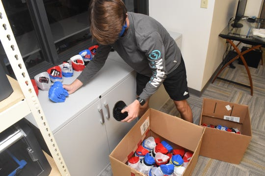 Wilson Anglin, a 2020 graduate of Holy Savior Menard High School, and a volunteer with PPE 3D Printing of Cenla, packs up reusable N95 masks made at Southern University. The masks are brought back to Alexandria where they are assembled by volunteers then distributed to health care workers. Anglin was the 3D designer for the robotics team at Menard.