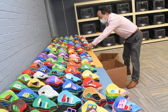 Jason Chang, director of information technology at Southern University and his team have produced nearly 2,000 N95 reusable masks using 40 desktop-sized 3D printers and a commercial-scale printer. The Southern lab prints the masks but volunteers in PPE 3D printing for Cenla assemble them.