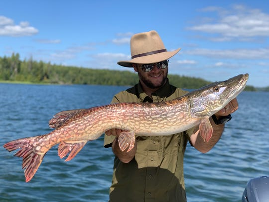Derek Zimmerman holds a Northern Pike at Pine Cliff Lodge in Ontario, Canada.