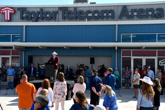 Doug McIntyre, president of the Abilene Chamber of Commerce, addresses the crowd during the opening of the new Taylor Telecom Arena Thursday.
