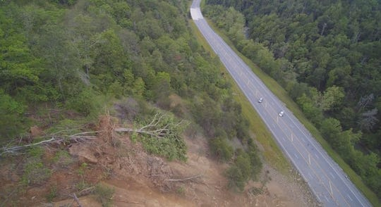 """Drone footage captures the rock slide down a steep mountain face that has U.S. 25-70 connecting Marshall with Weaverville closed """"indefinitely."""""""