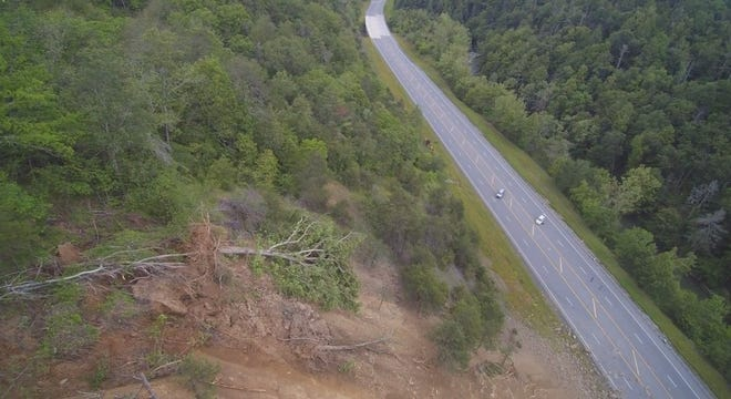 "Drone footage captures the rock slide down a steep mountain face that has U.S. 25-70 connecting Marshall with Weaverville closed ""indefinitely."""