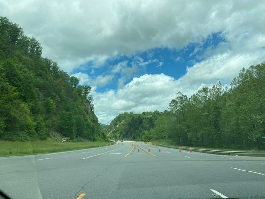 """A stretch of U.S. 25-70, commoly referred to as """"radar valley"""" remains closed """"indefinitely, according to NCDOT, as geotechnical engineers examine a rockslide location on a ridge roughly 200 feet above the well-traveled roadway."""