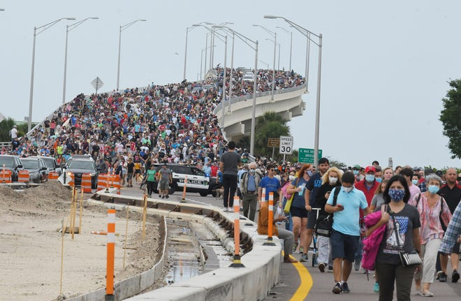 Mass exodus of SpaceX viewers walking back over the A. Max Brewer Bridge to their vehicles after the scrubbed launch announcement.