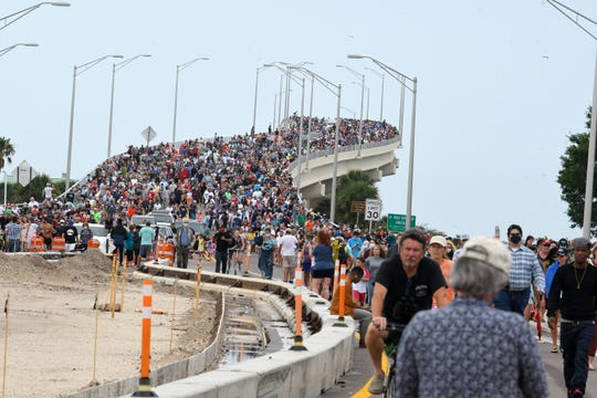 Large crowds of SpaceX spectators who left the A. Max Brewer Bridge after the announcement that the launch was scrubbing.
