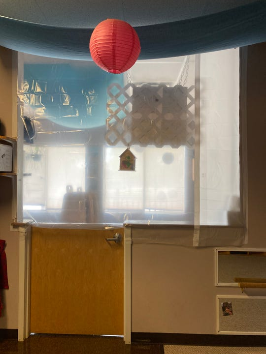 Frog & Toad Child Care & Learning Center in Essex has hung shower curtains over half walls to comply with safety guidelines in order to reopen in June, after being closed during the COVID-19 pandemic. Pictured May 28, 2020.