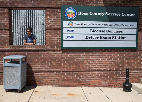 Mathias Sarlo stands outside the BMV as small lines form outside the building due to social distancing being practiced caused by the coronavirus epidemic on May 28, 2020.
