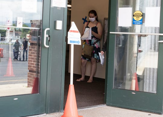 BMV customers must stand outside in the hallway as they are forced to social distance to help deter the increasing numbers of those getting sick from the coronavirus on May 28, 2020.