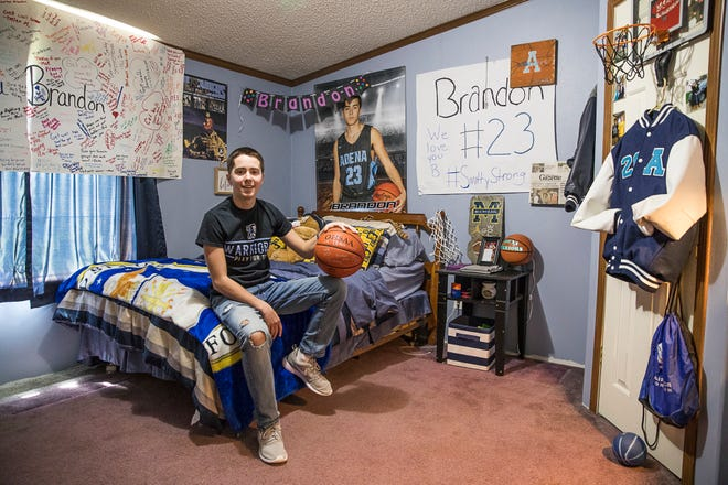 Adena senior Brandon Smith sits in his bedroom surrounded by the many tokens of support he has received after Brandon and his brother Jacob were in a near fatal accident in January of 2020.