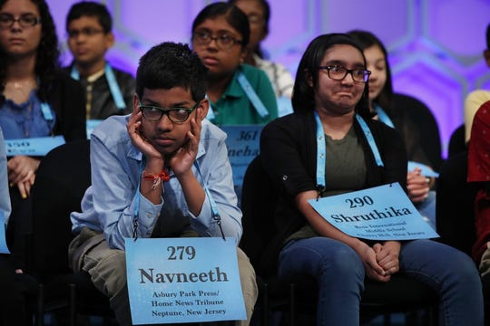 In this May 31, 2018 file photo, Navneeth Murali, then 12, from Edison, N.J., left, and Shruthika Padhy, then 12, from Cherry Hill, N.J., reacts during competition in the Scripps National Spelling Bee in Oxon Hill, Md., With the 2020 Scripps National Spelling Bee canceled because the coronavirus pandemic, an online spelling bee launched by two Texas teenagers is offering a consolation prize of sorts, with competitors nationwide including many of the kids who were considered favorites for the Scripps title.